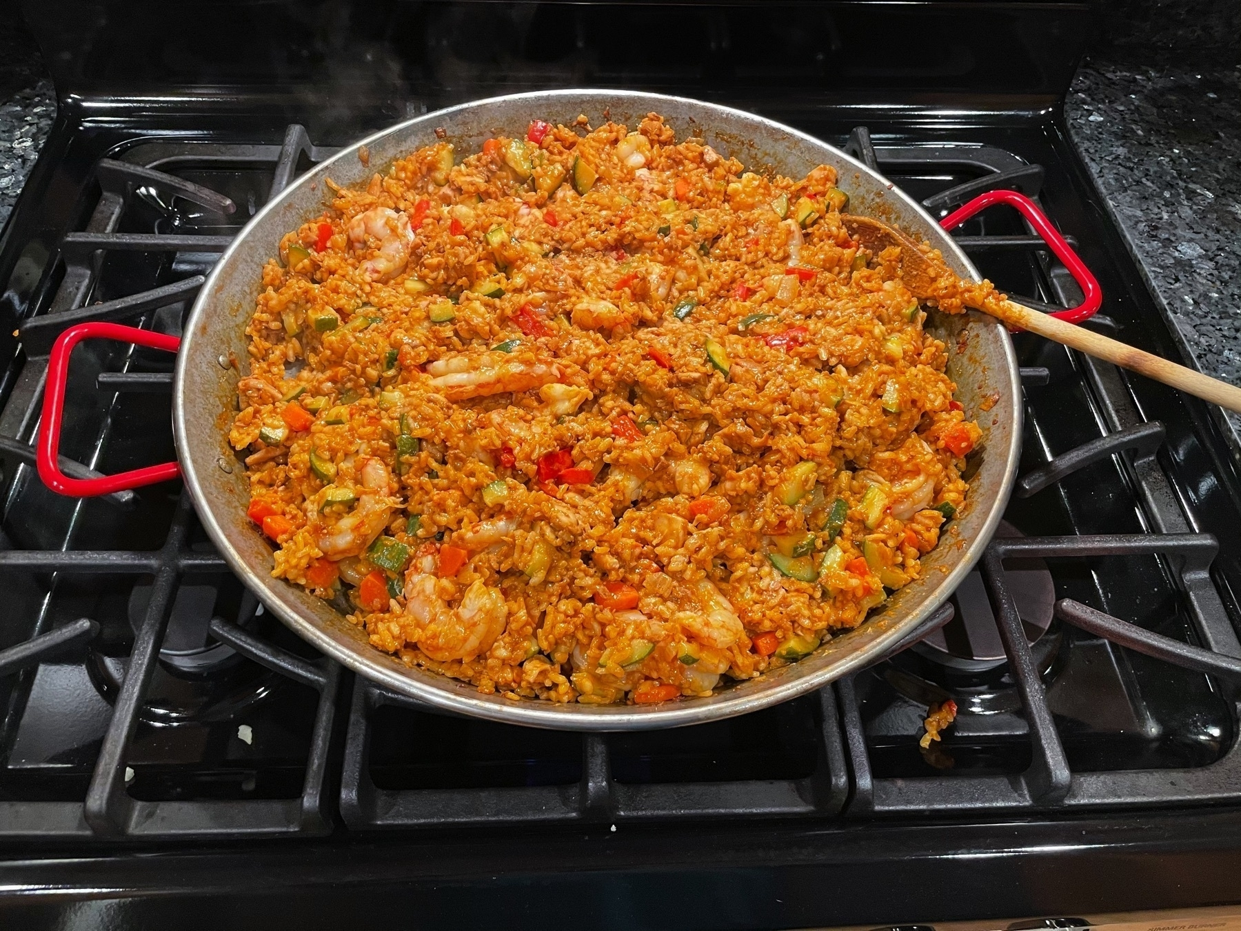 Fully cooked paella in paella pan.